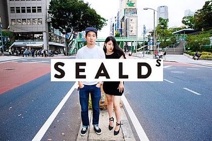 Fukuda posing for SEALDs